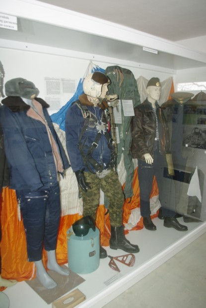 Details of a vitrine: Soviet air force winter, semi-season and summer flight suits are seen.